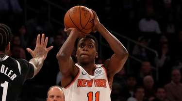 Frank Ntilikina of the Knicks puts up a