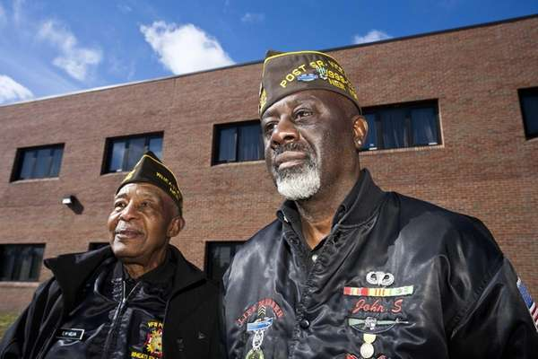 World Ware II veteran E. Mc Kelvin, left,