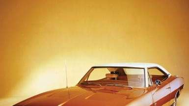A 1969 Dodge Charger is pictured. The Mopar