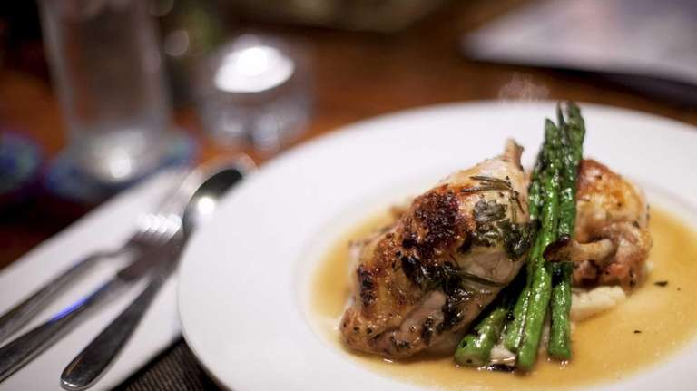 Oak Room Tavern's juicy, roasted chicken is served