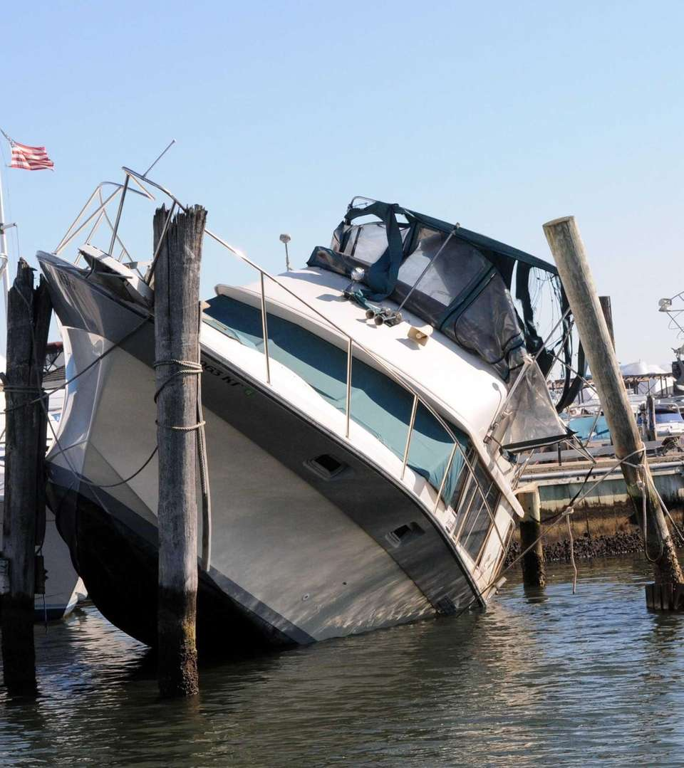 A damaged boat in the Anchorage Marina in