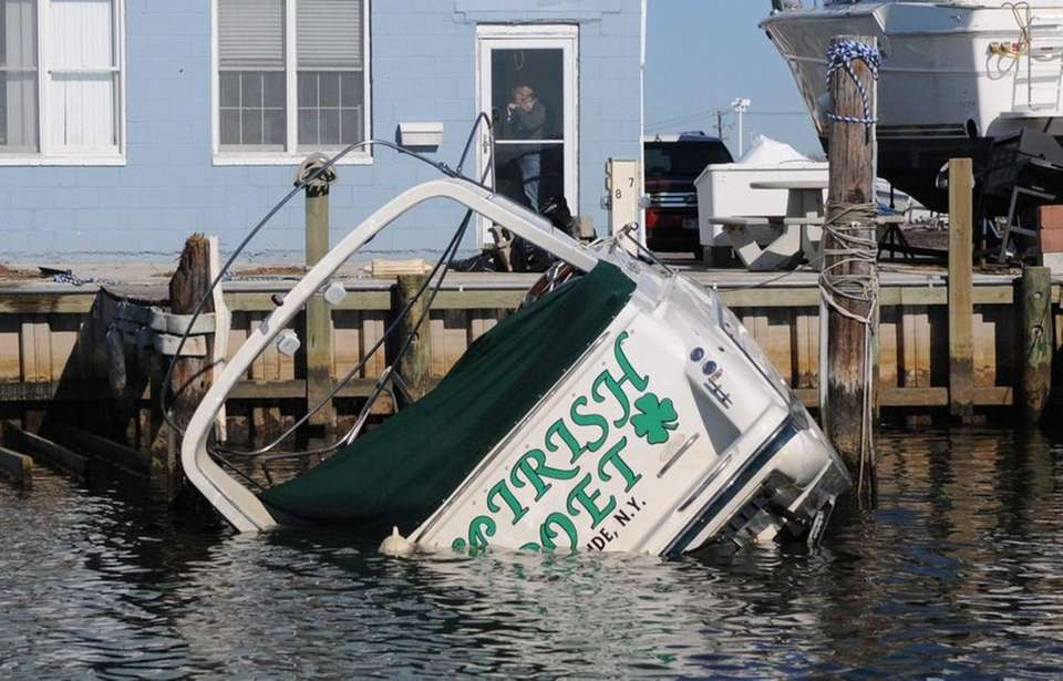 A boat takes on water after being damaged