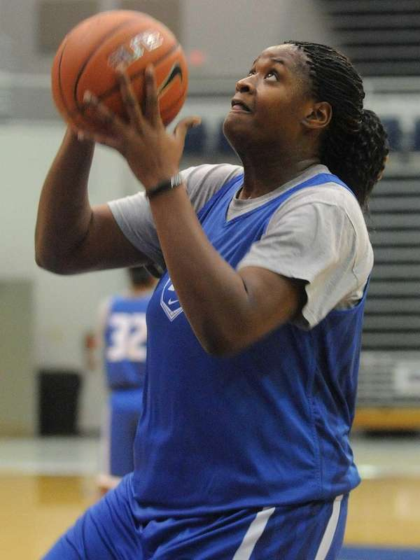 Hofstra's Shante Evans drives to the basket during