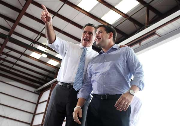 Mitt Romney, left, and Sen. Marco Rubio (R-FL)