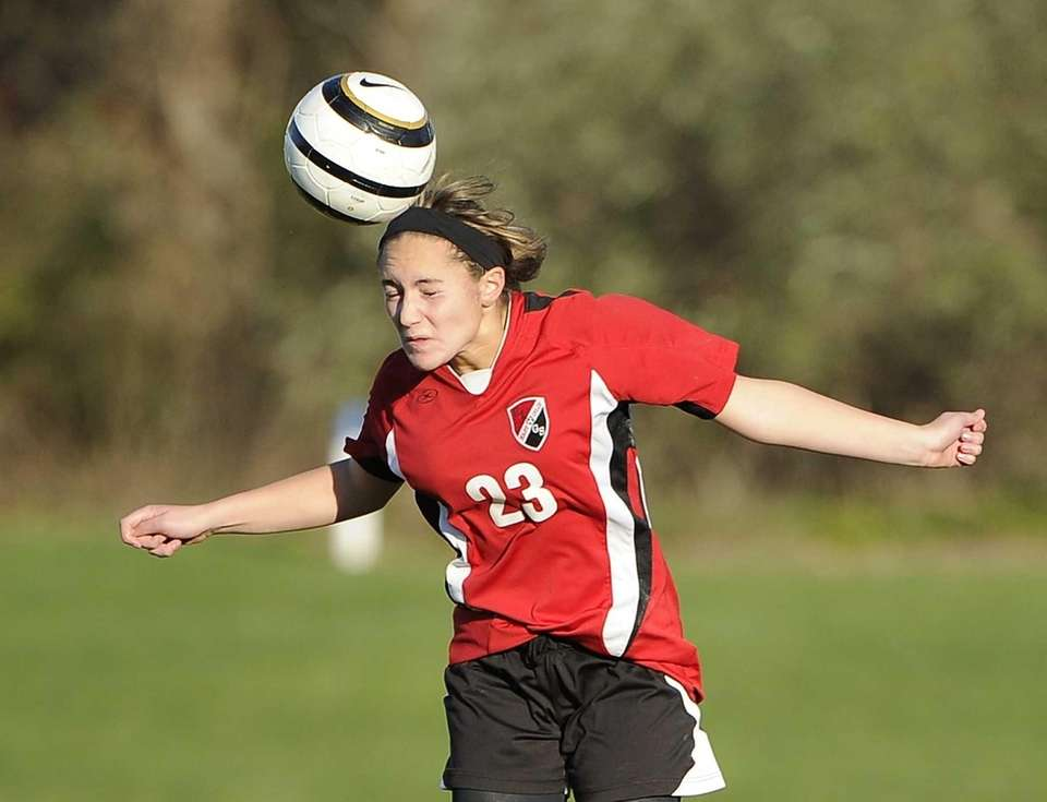 East Islip's Gianna Jennosa heads the ball against