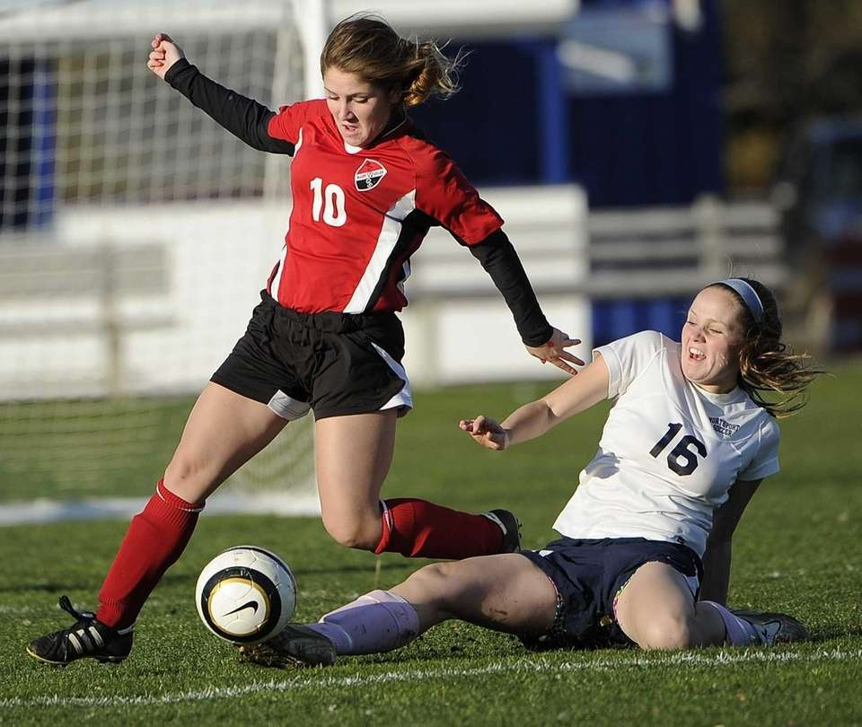 Northport's Emily Robarge slide tackles the ball away