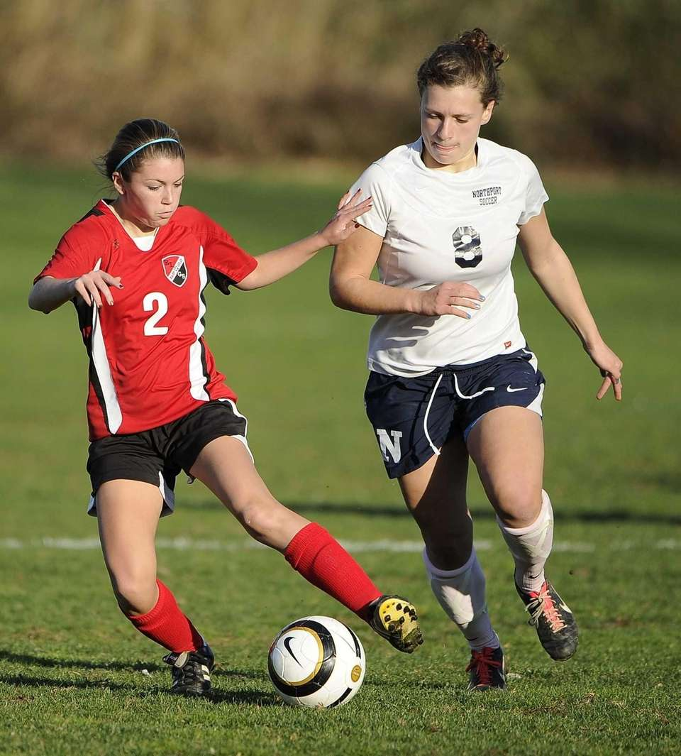 East Islip's Sydney Cammeyer protects the ball from