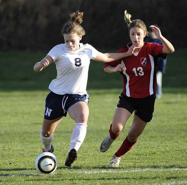 Northport's Kristin Desmond shoots on goal defended by