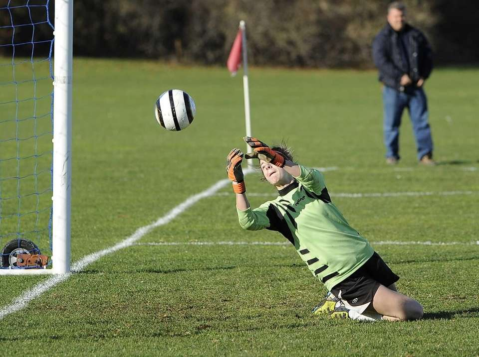 East Islip goalkeeper Kiersten Conway can't reach the