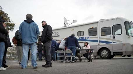 In the aftermath of superstorm Sandy, people wait