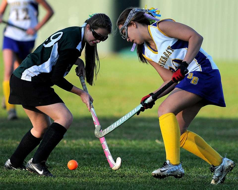 Oyster Bay's Joanna Sugar, right, and Carle Place's