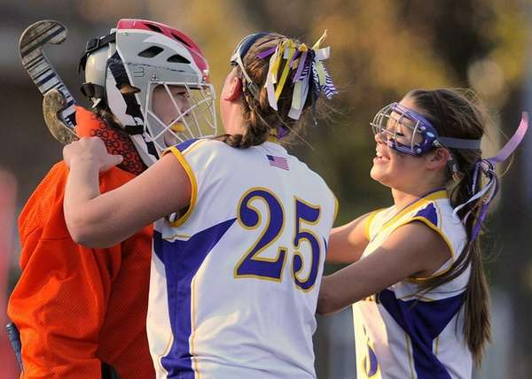 Oyster Bay goalie Anna Montick, left, gets congratulated