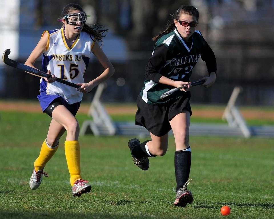 Carle Place's Shannon McGuinness, right, and Oyster Bay's