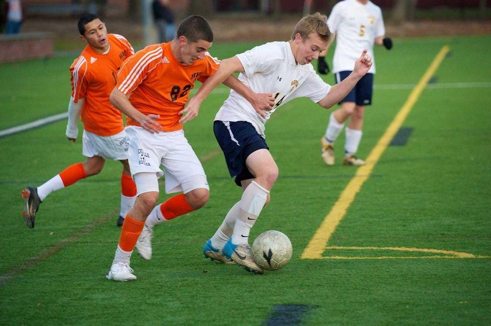 Massapequa senior Tyler Dowd battles for the ball