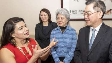 State Sen. Anna Kaplan, left, talks with China's
