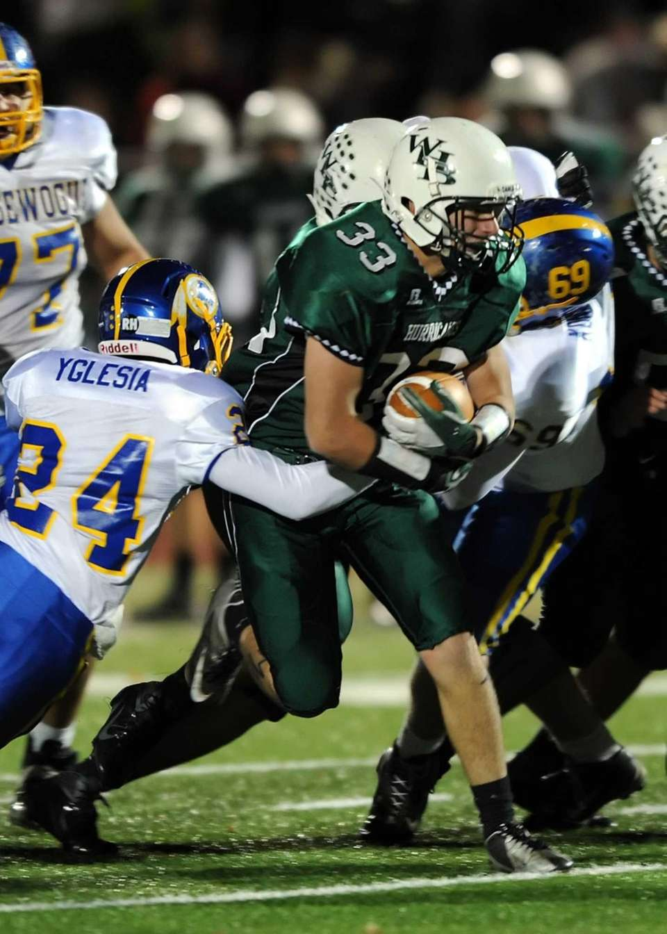 Westhampton's Patrick Dean powers for a first down.