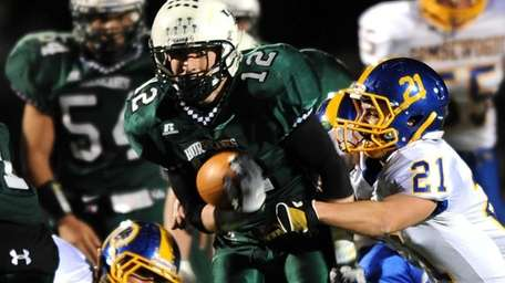 Westhampton's Brian Corrigan powers through Comsewogue's defense. (Nov.