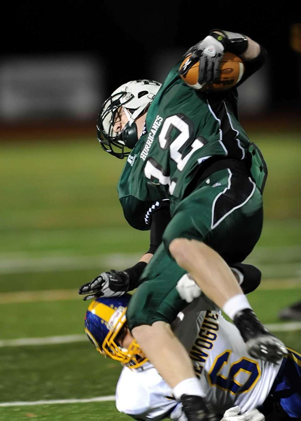 Westhampton's Brian Corrigan is tripped up by Comsewogue's