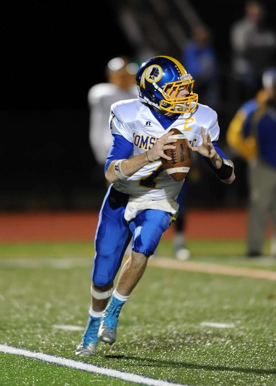 Comsewogue quarterback Ryan Keefe looks to pass down