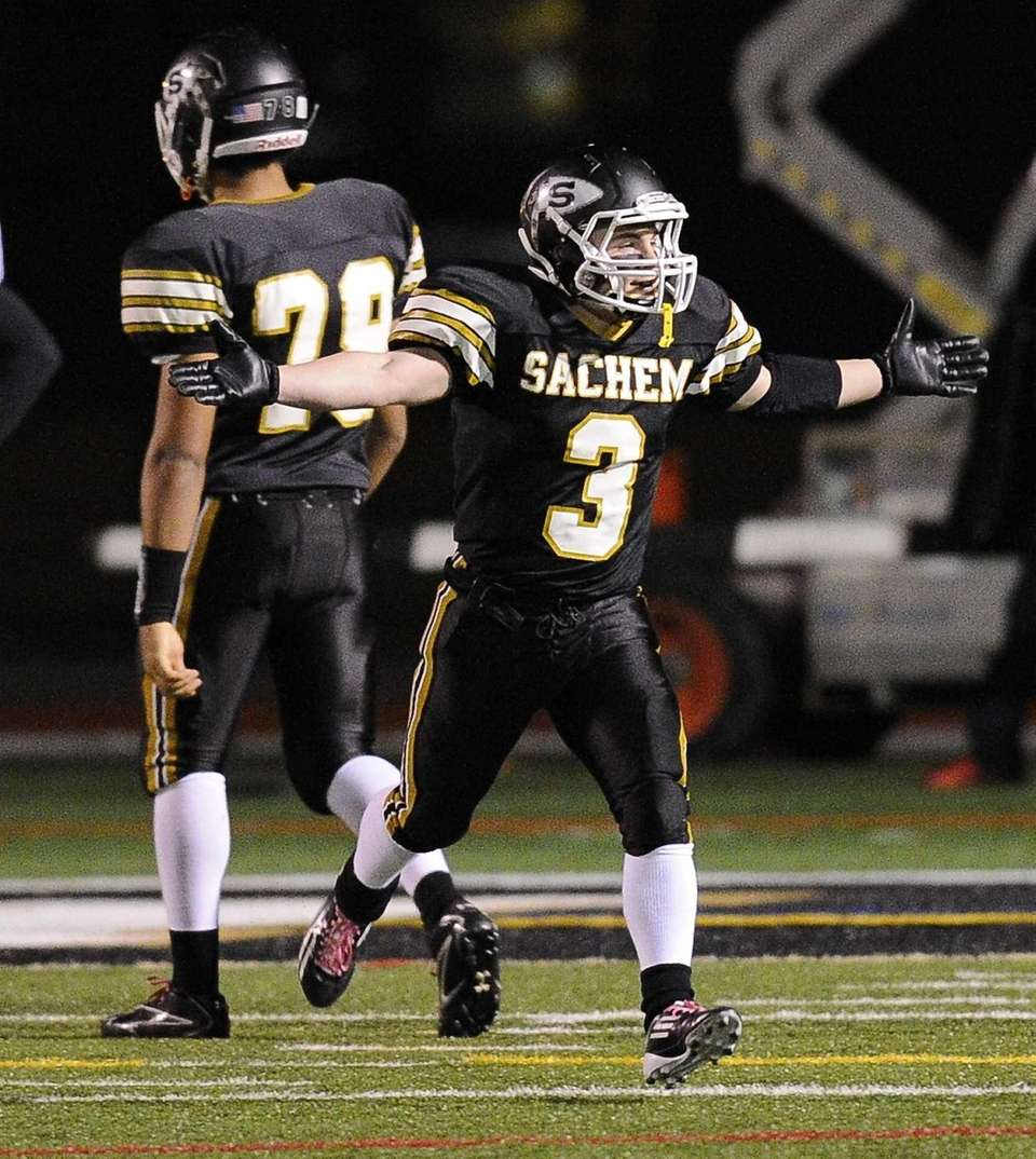 Sachem North's Kevin Lathan reacts after scoring a