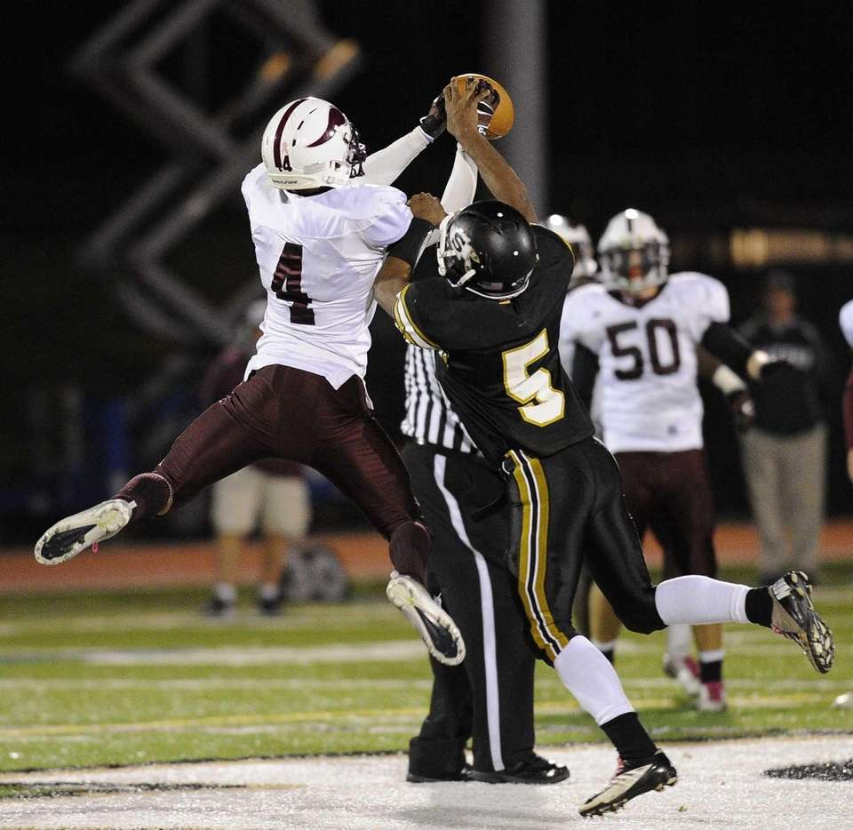 Sachem North's Malik Pierre breaks up a pass