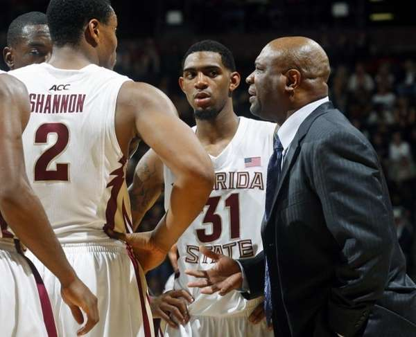 Florida State head coach Leonard Hamilton, right, talks