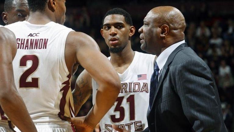 Florida State head coach Leonard Hamilton, right, talks
