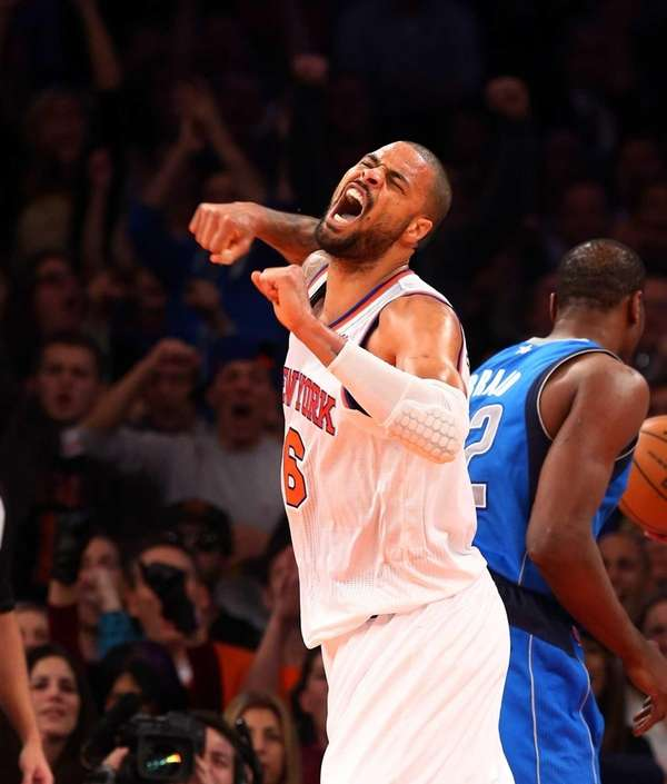 Tyson Chandler celebrates after drawing a foul after
