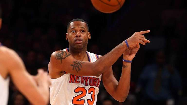 Marcus Camby passes the ball during a game