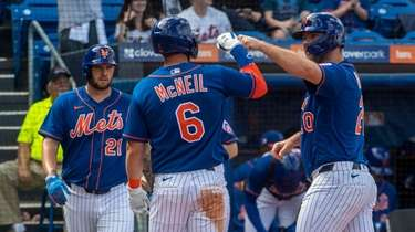 Mets' Pete Alonso celebrates with teammates as he
