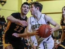Brandon Weiss of Jericho drives to the basket