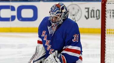 Igor Shesterkin of the Rangers makes a save