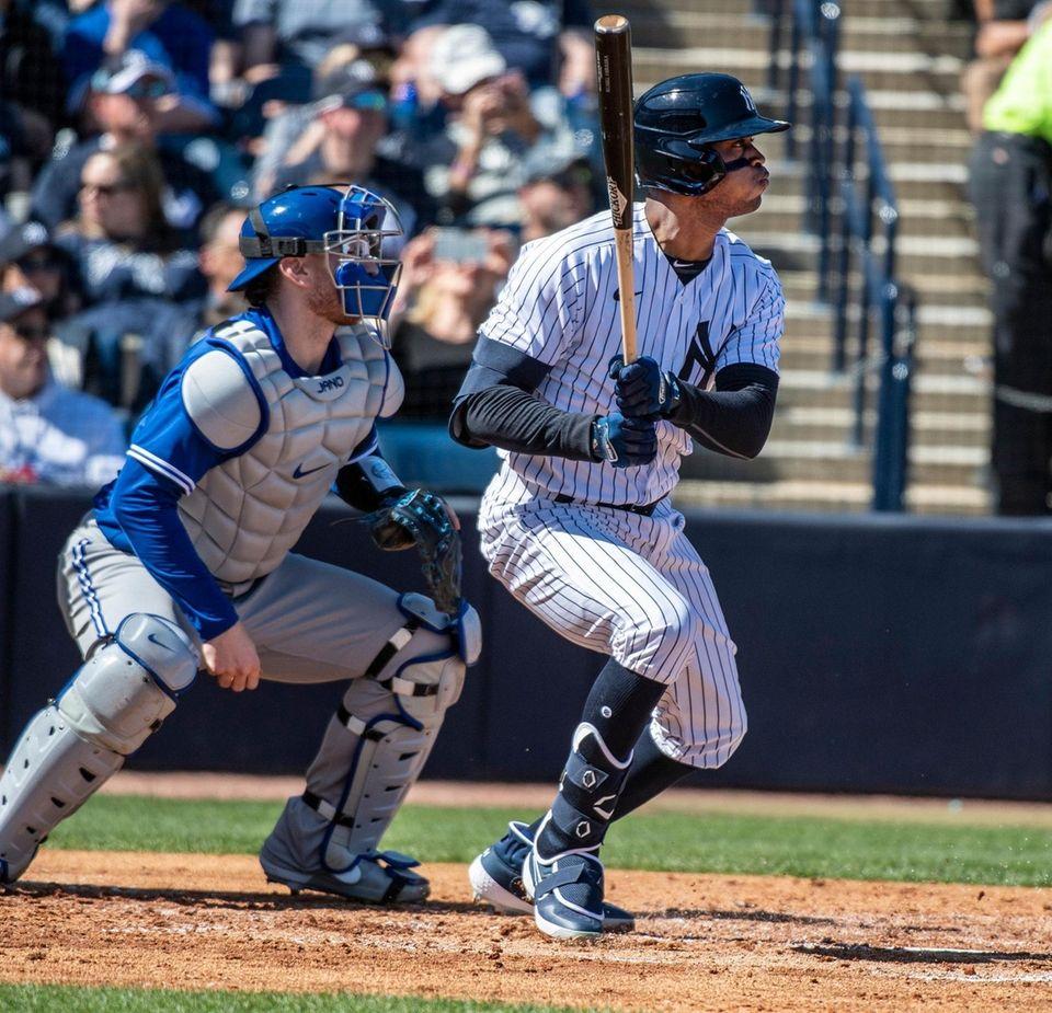The Yankees' Rosell Herrera hitting a single against