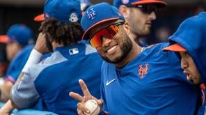 The Mets' Robinson Cano poses for the cameras