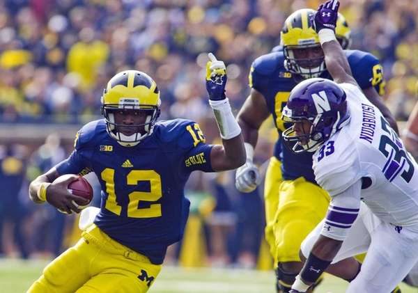 Michigan quarterback Devin Gardner tries to evade Northwestern