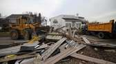 Village of Lindenhurst workers use heavy machinery to