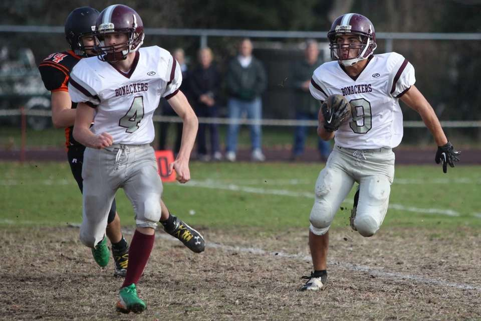 East Hampton's Peter Vaziri, right, runs the ball