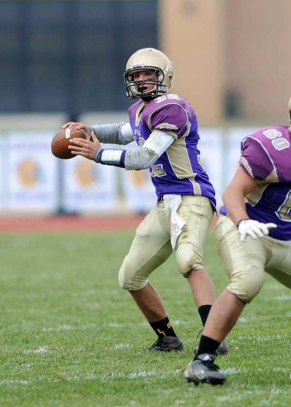 Sayville's Zachery Sirico looks to the end zone
