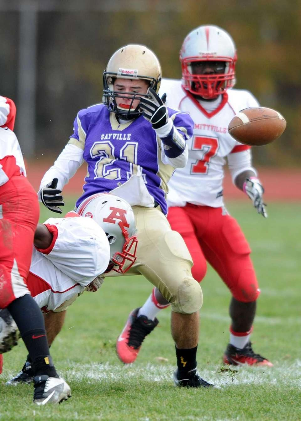 Sayville's Matt Selts loses the ball after a
