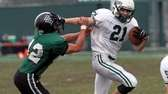 Locust Valley's Louis Jokinsky uses the stiff arm