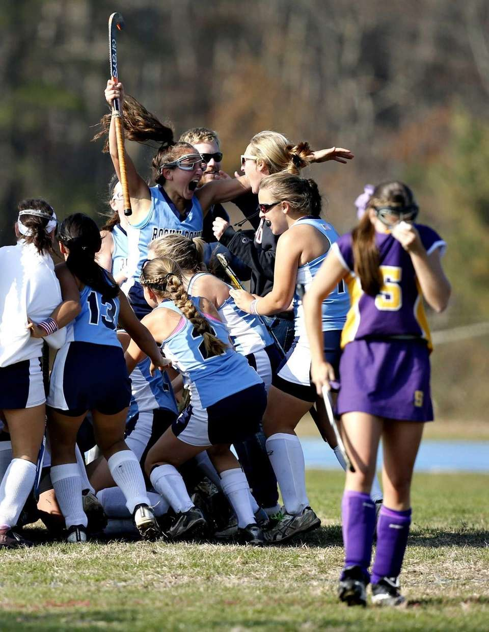 Rocky Point's field hockey team celebrates victory as