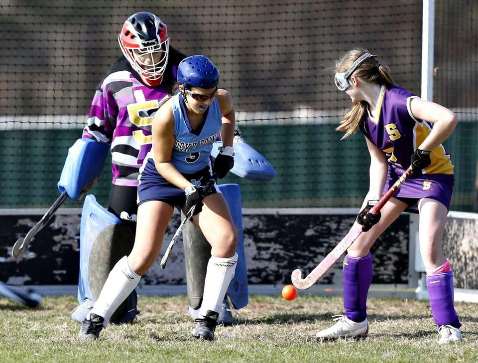 Rocky Point's Maggie DeFrank deflects a shot on