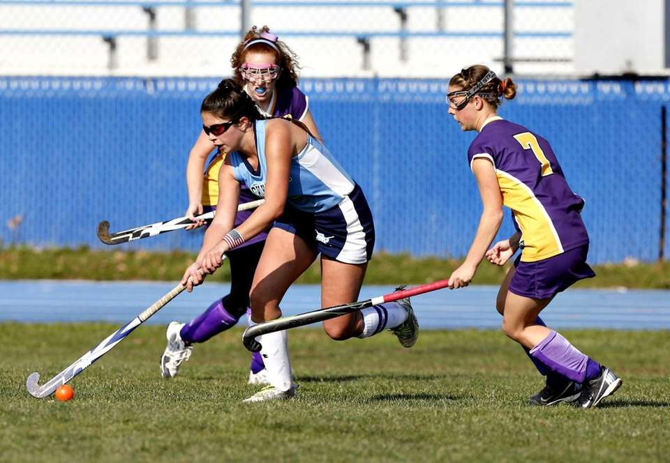 Rocky Point's Alyssa Milano splits Sayville defenders Claire