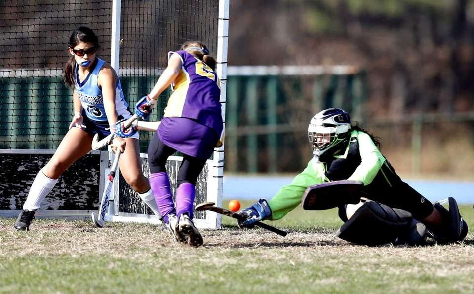 Rocky Point goalie Megan Palasek with a stick