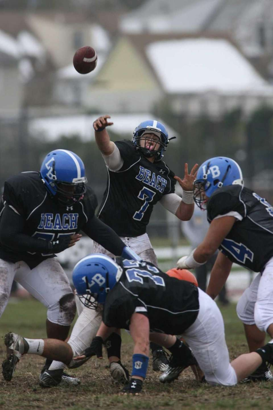 Long Beach quarterback Adam Salvadori throws an interception