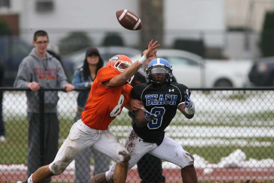 Carey's Michael DeLeo breaks up a pass intended