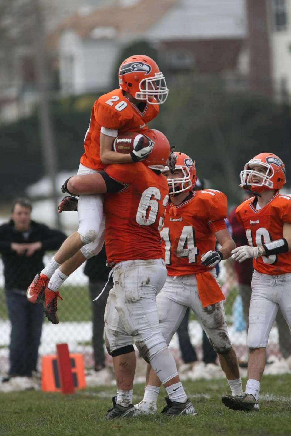 Carey's Dylan DeMeo celebrates scoring a touchdown with