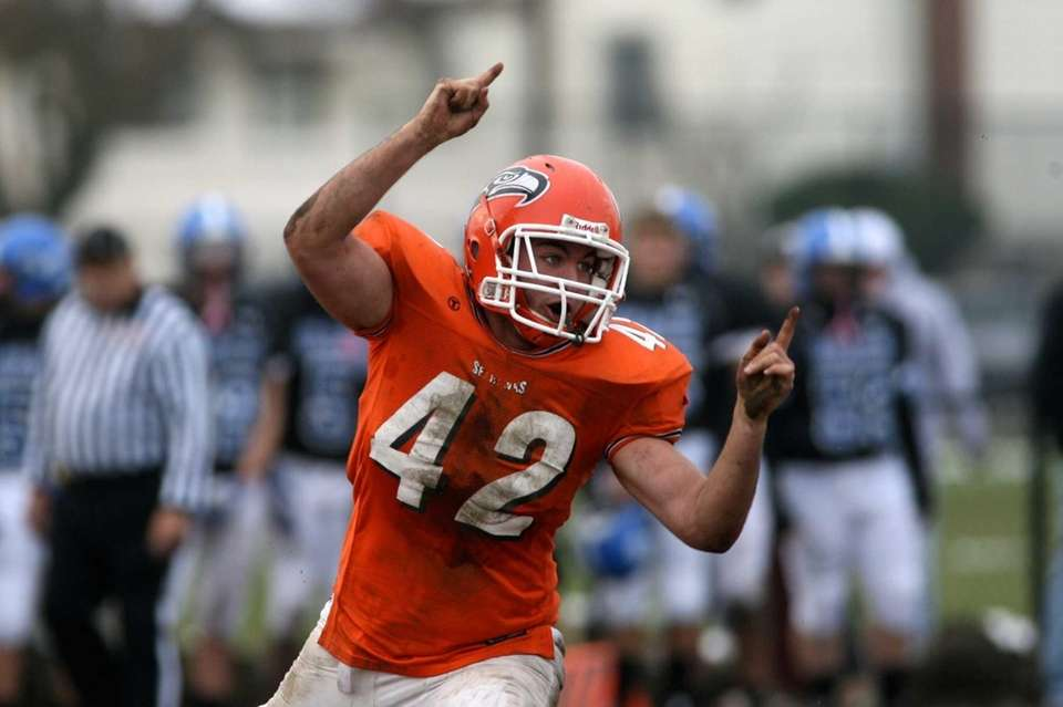 Carey's Thomas Dente reacts after he sacked Long