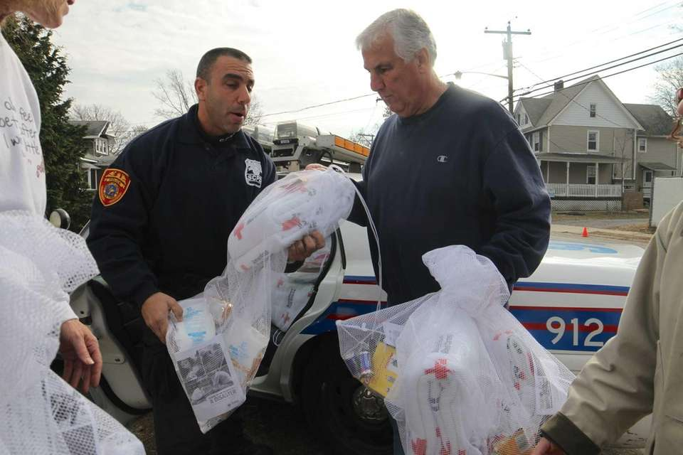 A Suffolk County Police Officer delivers supplies from