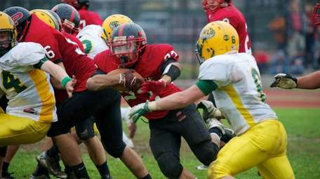 Plainedge running back Gianfranco Soriente attempts to break